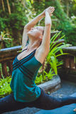 Young woman doing yoga outside in natural environment Royalty Free Stock Photo