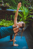 Young woman doing yoga outside in natural environment Stock Photography