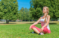 Young woman doing yoga. Young woman doing yoga in the park Stock Images