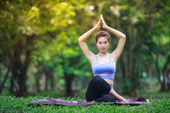 Young woman doing yoga in the park Royalty Free Stock Photography