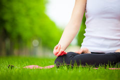 Young woman doing yoga in the park. Stock Photography
