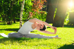 Young woman doing yoga in the park in the morning Royalty Free Stock Image