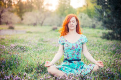Young woman doing yoga in Park Royalty Free Stock Photography