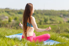 Young woman doing yoga pose outdoor in the morning Stock Photos