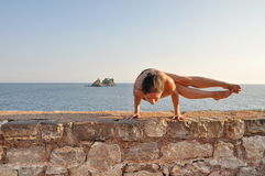 Young woman doing yoga pose Royalty Free Stock Photos