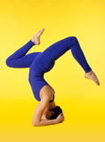 Young woman doing yoga pose - stand on head Stock Photos