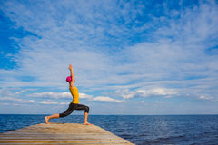 Young woman doing yoga pose royalty free stock photography