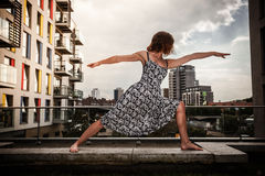 Young woman doing yoga on roof top Royalty Free Stock Photography