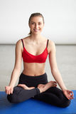 Young woman doing yoga sitting in lotus posture Stock Images