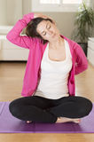 Young woman doing yoga stretching exercise Royalty Free Stock Image