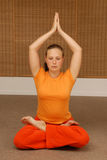 Young woman doing yoga in the sunny room stock photos