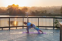 Young woman is doing yoga on the sunrise stock photos