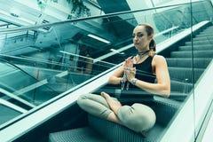 Young woman doing yoga. Urban Yoga. Yoga meditation. Stock Photos