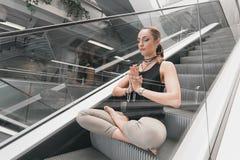 Young woman doing yoga. Urban Yoga. Yoga meditation. Royalty Free Stock Image
