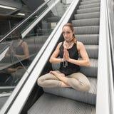 Young woman doing yoga. Urban Yoga. Yoga meditation. Royalty Free Stock Photo