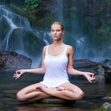 Young woman doing yoga in the water stock photo