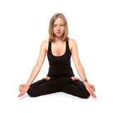 Young woman doing yoga Stock Photos