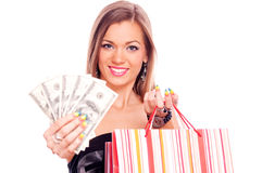 Young woman with Dollar bills and shopping bag Royalty Free Stock Photos