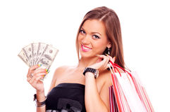 Young woman with Dollar bills and shopping bag Stock Images