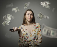 Young woman and dollars Stock Images