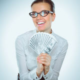 A young woman with dollars in her hands, isolated on white background.  Royalty Free Stock Images
