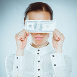 A young woman with dollars in her hands, isolated on white background.  Stock Photography