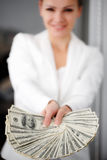 A young woman with dollars in her hands, isolated on white. Business woman holding a bunch of money and board royalty free stock photo