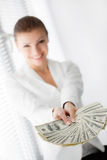 A young woman with dollars in her hands, isolated on white. Business woman holding a bunch of money and board stock images