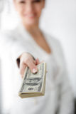 A young woman with dollars in her hands, isolated on white. Business woman holding a bunch of money and board royalty free stock photos