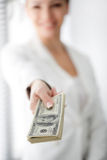 A young woman with dollars in her hands, isolated on white Stock Photos