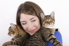Young woman with domestic cats. Royalty Free Stock Photo