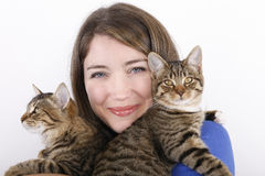 Young woman with domestic cats. Royalty Free Stock Photos