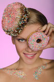 Young woman, donut on head and front of eye Royalty Free Stock Image