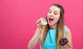 Young woman with donuts stock photography