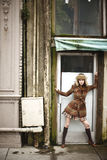 Young woman in doorway Royalty Free Stock Photography