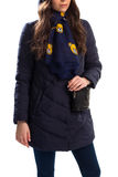 Young woman in down jacket. Navy scarf with bear pattern. Winter outfit and classic handbag. Outerwear of polyester Stock Images