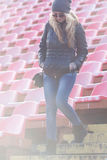 Young woman down the stairs of the stadium. The February stroll with a young woman Royalty Free Stock Photography