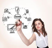 Young woman drawing a cloud computing on whiteboard Royalty Free Stock Images