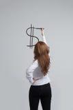 Young woman drawing dollar symbol Royalty Free Stock Photo