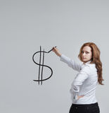 Young woman drawing dollar symbol Stock Image