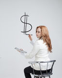 Young woman drawing dollar symbol Royalty Free Stock Images