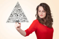 Young woman drawing a food pyramid on whiteboard Stock Photography