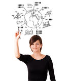 Young woman drawing globe with diagrams isolated on white Stock Images