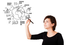 Young woman drawing globe with diagrams isolated on white Royalty Free Stock Images