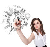 Young woman drawing a globe on whiteboard Stock Images