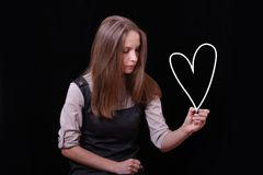 Young woman drawing heart shape Royalty Free Stock Photography