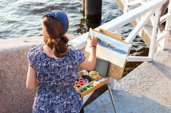 Young woman drawing navy warships  at the outdoors in sunny day Stock Images