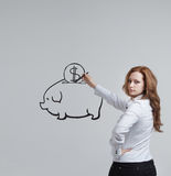 Young woman drawing a piggy Bank Stock Photos