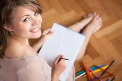 Young woman drawing Stock Photography