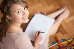 Young woman drawing Royalty Free Stock Photo
